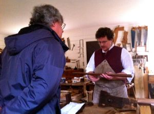 Bill has a talk with one of the cabinet makers.