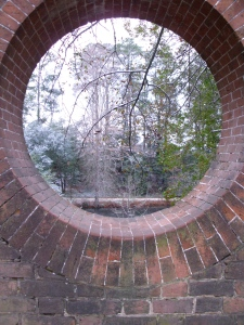 Window through the garden wall looking out to the canal.