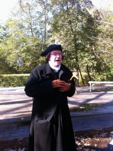"A first-person interpreter takes on the persona of founding father Patrick Henry for ""A Public Audience with Patrick Henry"" in the garden behind the Palace."