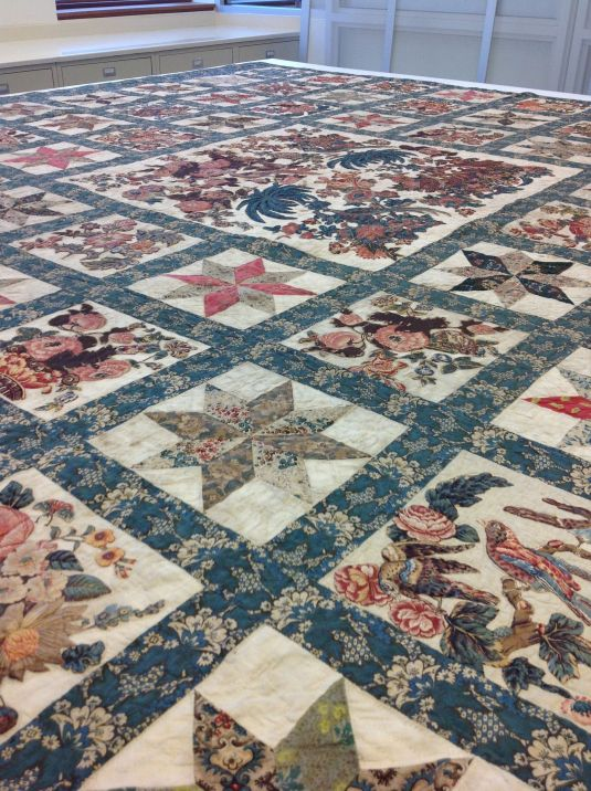Over sized quilt being restored at the Textile Lab