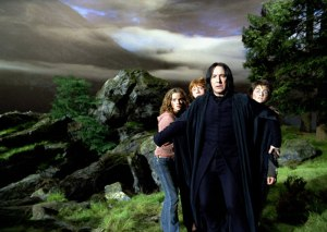 Still from HP and the Prisoner of Azkaban. Snape rushes in front of Harry, Ron and Hermione to protect them from a werewolfe. Maybe he's just being a good teacher/adult. But I doubt whether some other teachers at the school would have done the same. [Image courtesy: Warner Brothers]