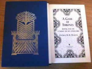 Dust slipcase and title page of George R.r. Martin's A Game of Thrones.