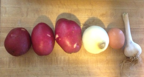 A line up of the usual suspects... Red Potatoes, Onion, Egg, and Garlic... wait to be transformed