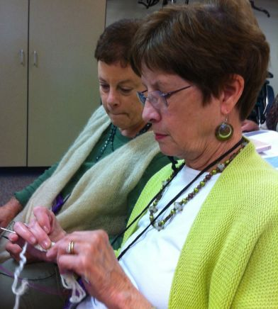 My bestest knitting buddy Sheila (front) picks up a cabling technique in our Aran class.