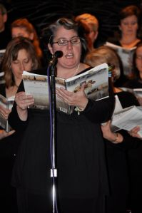 """A more modern photo of me singing the part of the Voice of God 2 in """"Can You Hear Me Now?"""" with the Our Lady of Grace music group in 2011."""