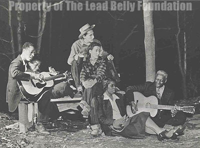 Lead Belly with Josh White and others. (Image courtesy: the Lead Belly Foundation.)