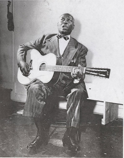 Lead Belly singing and playing the 12 string. (Image courtesy: the Lead Belly Foundation)