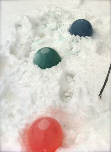 Ice marbles in the process of freezing in the snow.