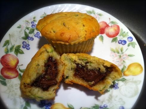 A little Nutella surprise is hidden in side these zucchini muffins. The perfect way to warm up on a snowy day.