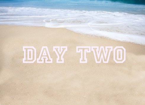 Beautiful tropical beach with the word summer written on the san